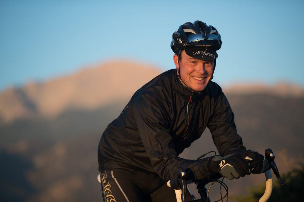 Zach Owen pauses during a bike ride