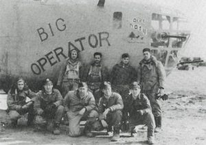 WWII navigator Lt. Vernon Bingham, second from left, and his crew in front of their B-24 bomber.