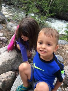 Daniell's son plays on rocks with his girl cousin.