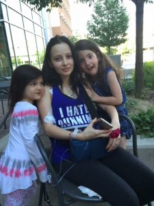 Danielle gets a visit from her little sisters during her treatment at UCHealth's University of Colorado Hospital.