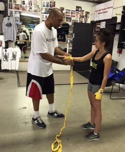 Danielle working out with her boxing trainer.