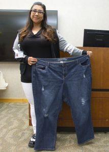 Misty Garcia holding a plus-size jean