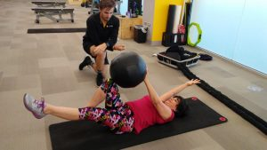 In this photo, Andrea Meyers is shown exercising with BFitBWell exercise specialist Ian Moran.