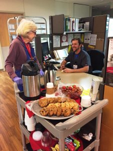 Joan Gibbs, the Cookie Lady, passing out cookies.