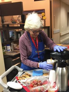 Joan Gibbs, the Cookie Lady pours coffee to go along with her delicious creations.