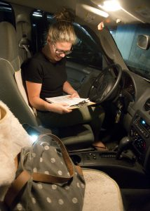Eleanor Mills, an emergency department professional research assistant, is shown during an inspection of a patient's car.