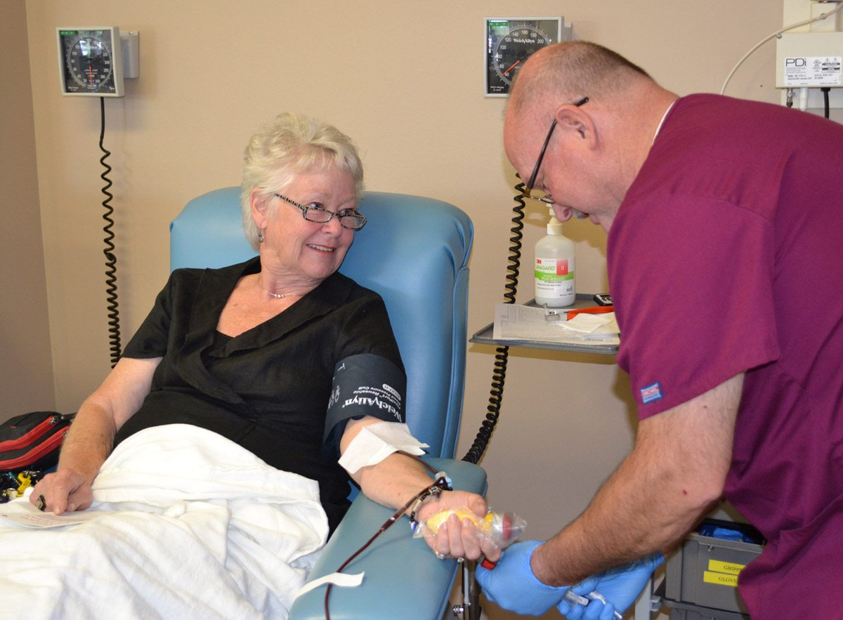 Babs Finkle makes a donation in 2016. Seasonal lull impacts local blood supplies.