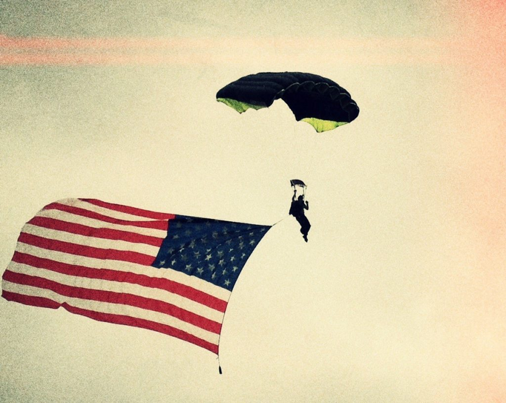 Jeff Bramsted, an organ donor for a liver transplant, skydives with an American flag.