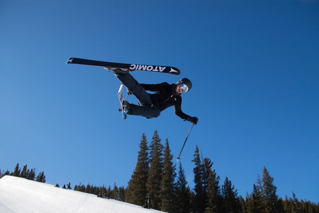 Allie Welsh flies through the air as she practices halfpipe skiing at Copper Mountain.