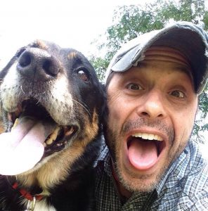 Actor Jordan Leigh poses in a close-up selfie with his dog, Daisy. Leigh ruptured both Achilles tendson within seconds durign a crazy accident.