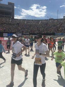 Becky Pomerleau running in a race after her transplant.
