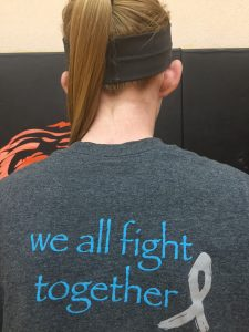Makayla Brossman wears a T-shirt that shows how the Cheyenne Wells community is supporting her mother.