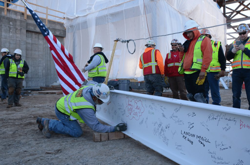 Construction crews at the site of the future UCHealth Highlands Ranch Hospital celebrated a major milestone by signing their names on a metal beam.