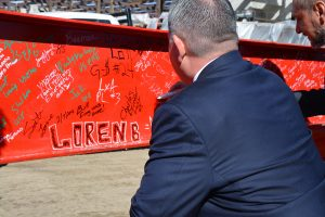 UCHealth Memorial Hospital President and CEO Joel Yuhas signs his named to a steel beam as part of a celebration marking a milestone in construction at Memorial Hospital North.