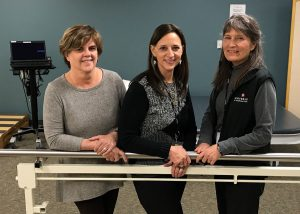 From left, Nancy Malley, Patricia Kupyer and Carol Gertsch, the UCHealth Medical Center of the Rockies team that led Aaron Macpherson through the speech, occupational and physical therapy involved in his stroke recovery.
