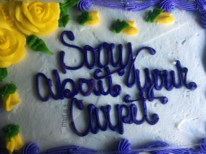 A cake that reads sorry about your carpet. Photo courtesy of Cheryl Harrell