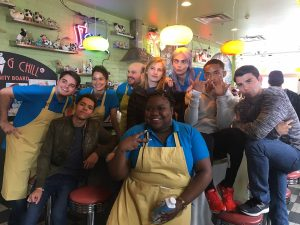 Peyton poses with actors at an ice cream shop in Toronto during the filming of Life in a Year.