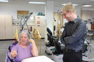 Dr. Patrick Johnston observes Barb Wheeler's progress during a therapy appointment.
