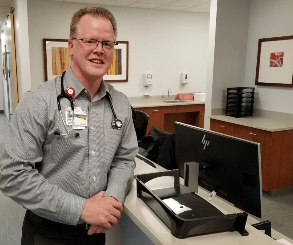 Dr. Gregory Ambuske, an internal medicine physician, is pictured at the UCHealth Primary Care Clinic-Broomfield.