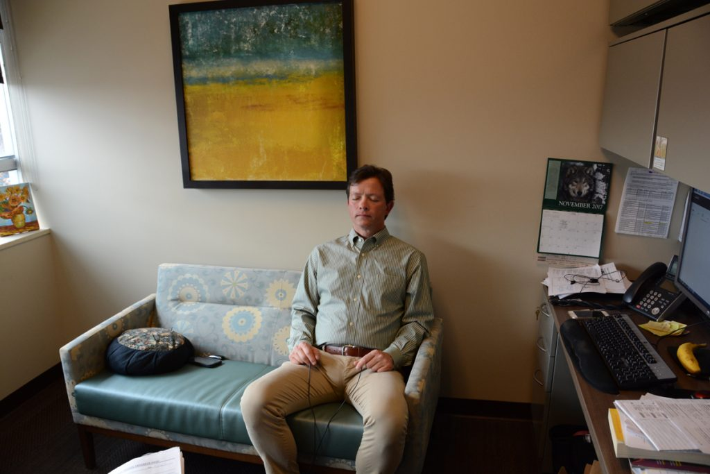 Patrick Gaines sits on a couch in his psychologist's office at the UCHealth Center for Integrative Medicine, where he uses alternatives to opioids in dealing with chronic pain.