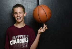 Parker Teff spins a basketball on his left finger. He was born with cerebral palsy, but stays loose and healthy through sports.