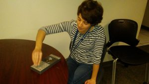 Isabelle Buard, CU neurologist demonstrates the pegboard test | UCHealth