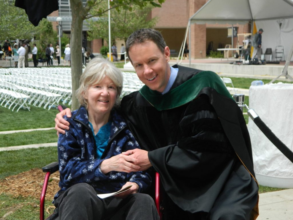 Dr. Jeffrey Lewis poses at his medical school graduation with his mom, Dr. Jeanne Lewis. She was a hometown doctor in Boulder. Now he's following in her footsteps.