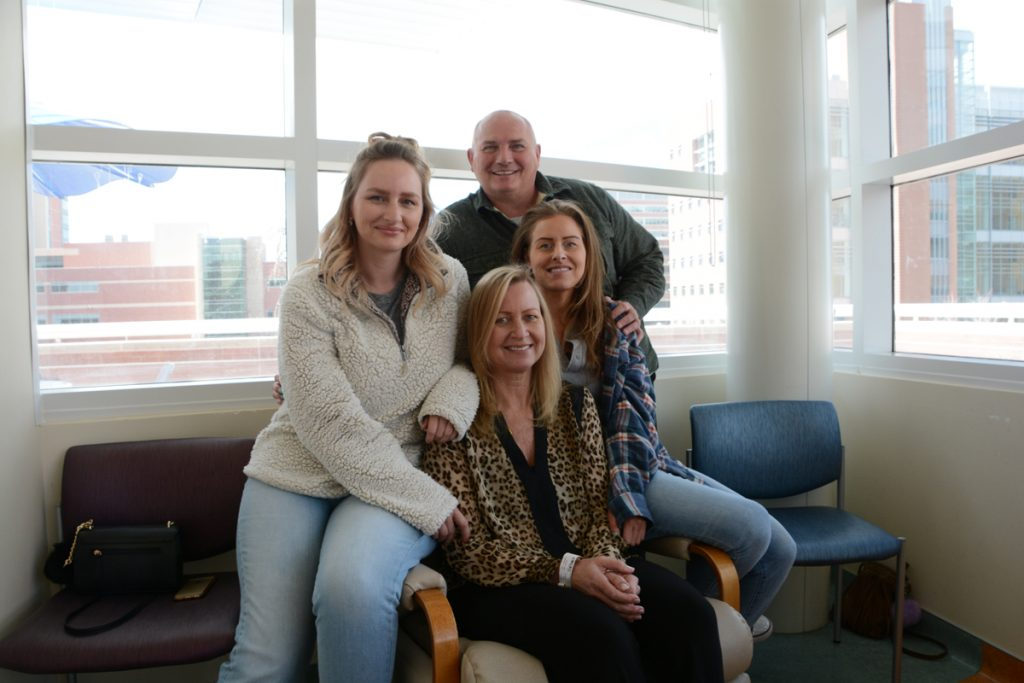Cancer patient Evelyn Schwandt withher two grown daughters and her husband at UCHealth University of Colorado Hospital. The family supports Schwandt as she copes with two unrelated cancers.