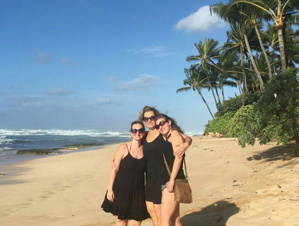 Evelyn Schwandt poses on the beach in Hawaii with her two grown daughters.