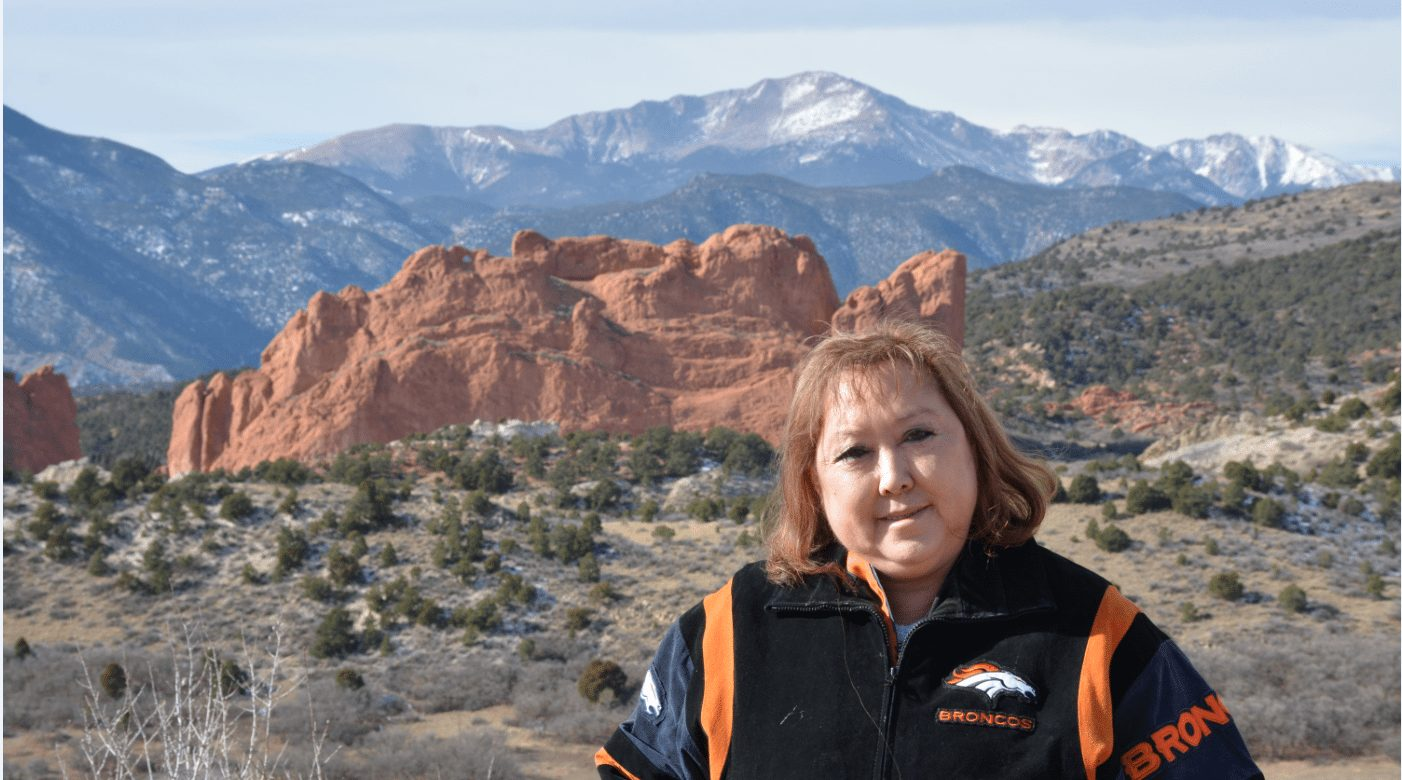 Linda Regis is pictured in front of Kissing Camels at the Garden of the Gods, with Pikes Peak in the background