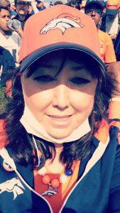 Linda Regis is pictured in Broncos gear.