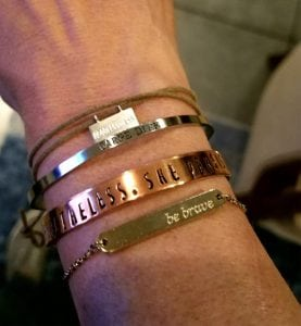 "An arm with bracelets. They have positive messages like ""be brave."""