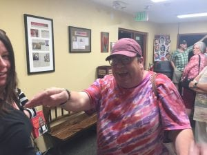 Greg West reaches out to give his fans from UCHealth a hug after performing in the show, Superior Donuts.