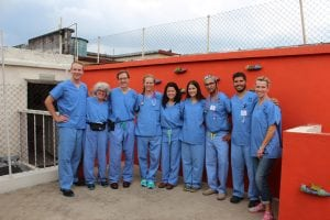 A group of care providers poses outside a clinic in Guatemala City.