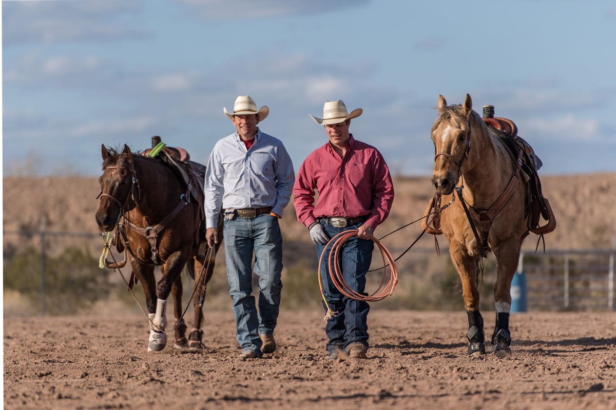 Archie-and-Jason-walking-with-their-horses-sized-for-slideshow