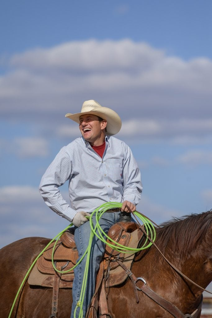 Rancher Archie Chant smiles as he sits on his horse. Chant survived a head-on collision that nearly cost him his leg and his life. Now, he's riding, roping and ranching again.