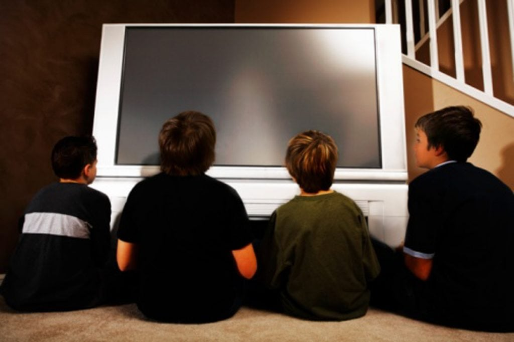 Young boys in front of a television