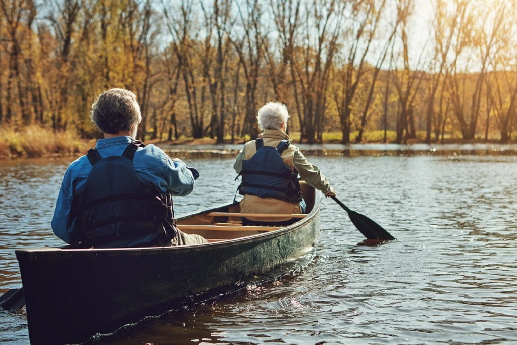 Shot of a senior couple going for a canoe ride on the lake