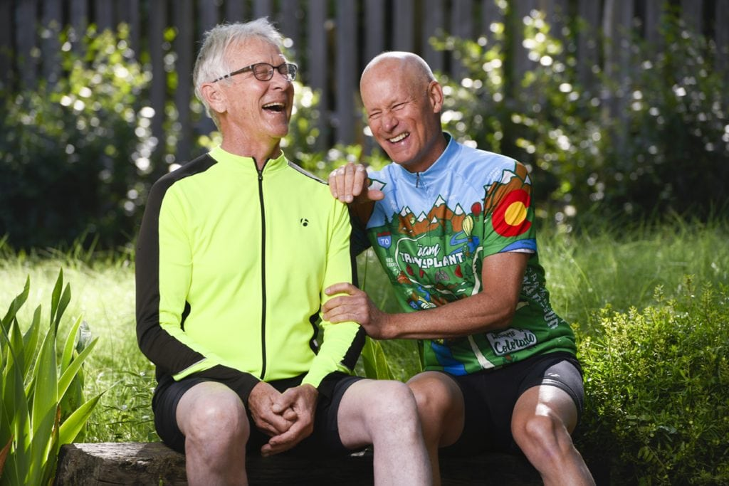 Jim Eastman left, and Scott La Point have bonded like brothers since La Point donated one of his kidneys to Eastman. Here they sit next to one another wearing cycling gear. They're laughing as they sit side by side.