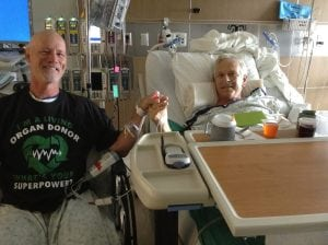 Scott La Point, left, holds Jim Eastman's hand in UCHealth University of Colorado Hospital after their transplant surgery last June. Photo courtesy of Scott La Point.
