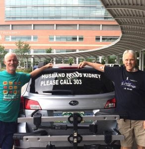 """The photo shows Scott La Point, the kideny donor, standing with his kidney recipient, Jim Eastman. They are posing with the car that had the sign, """"Husband needs Kidney."""" It now says Husband Got Kidney."""