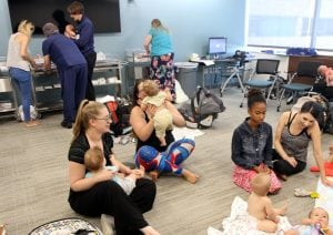 Activity at the breastfeeding support groups include moms nursing, weighting their babies and talking to lactation consultants.