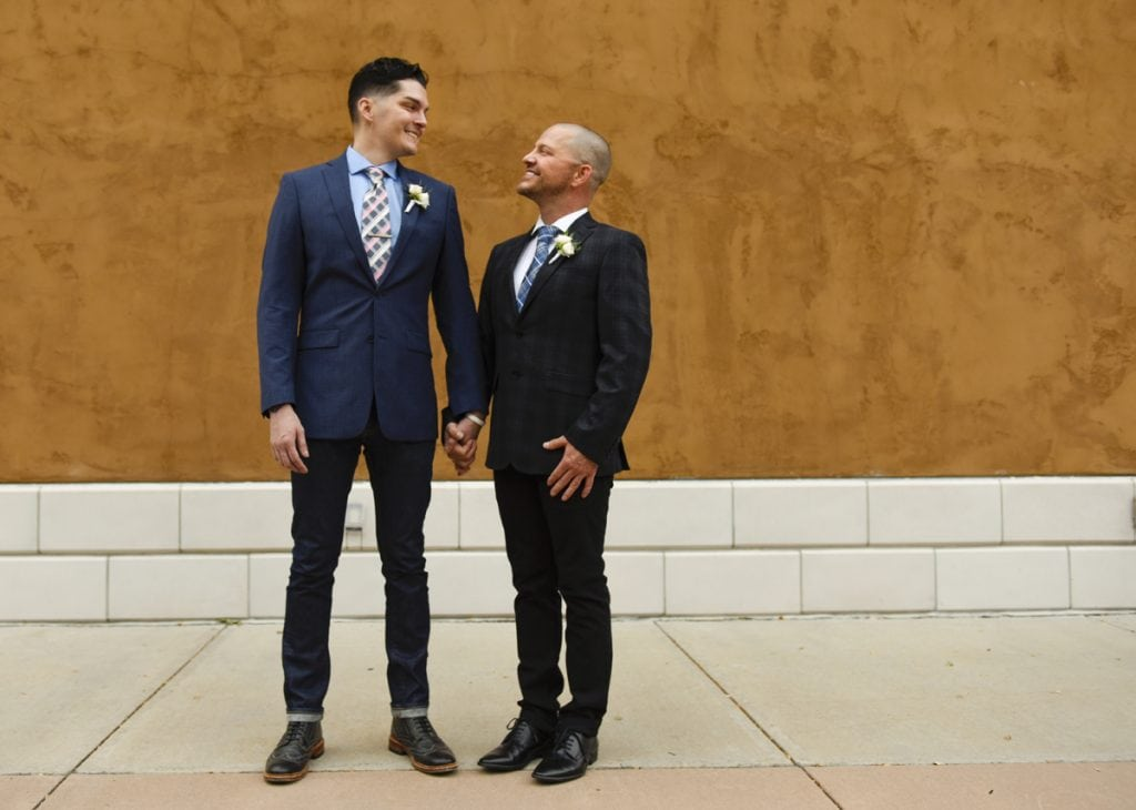 Stephen Estrada, left, and Kenley Erskine, right on their wedding day. The two pose outside a Denver restaurant where they were married.