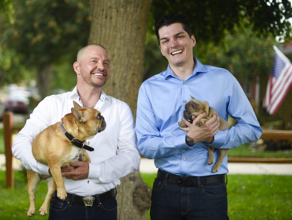 Kenley Erskine, left, and Stephen Estrada, right, with two of their dogs before their wedding on Aug. 1. Stephen holds the puppy, whose name is Mr. Jimmy Chews. Kenley holds Gretl. Photo by Cyrus McCrimmon for UCHealth Today.