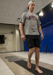 Reflectors on Hammond's ankles and feet are tracked by eight cameras mounted high on the UCHealth Foot and Ankle Center's clinical motion and performance laboratory walls as he walks across force plates, part of a complex mix of technologies that combine to help diagnose problems related to and emanating from the feet.
