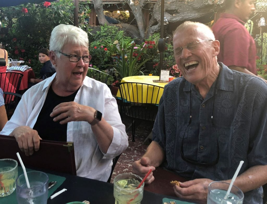 Bill Brennan with his wife of 56 years. Both are laughing after Bill has serenaded his wife.