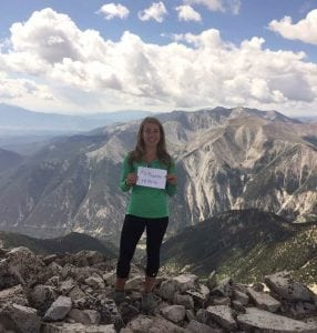 Daniell Fixen poses at the top of a Colorado 14er. Fixen is a pharmacist who has had to learn more about whether marijuana is safe for older adults since she works at a clinic where many older patients are asking if marijuana is safe.