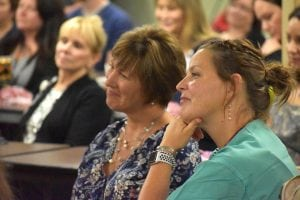 Two women smile proudly as they listen to remarks about Poudre Valley Hospital's latest recognition.
