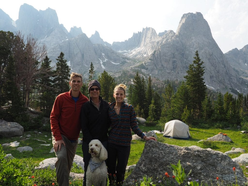 A photo of a family before a backdrop of jagged peaks in the Wind River Wilderness.
