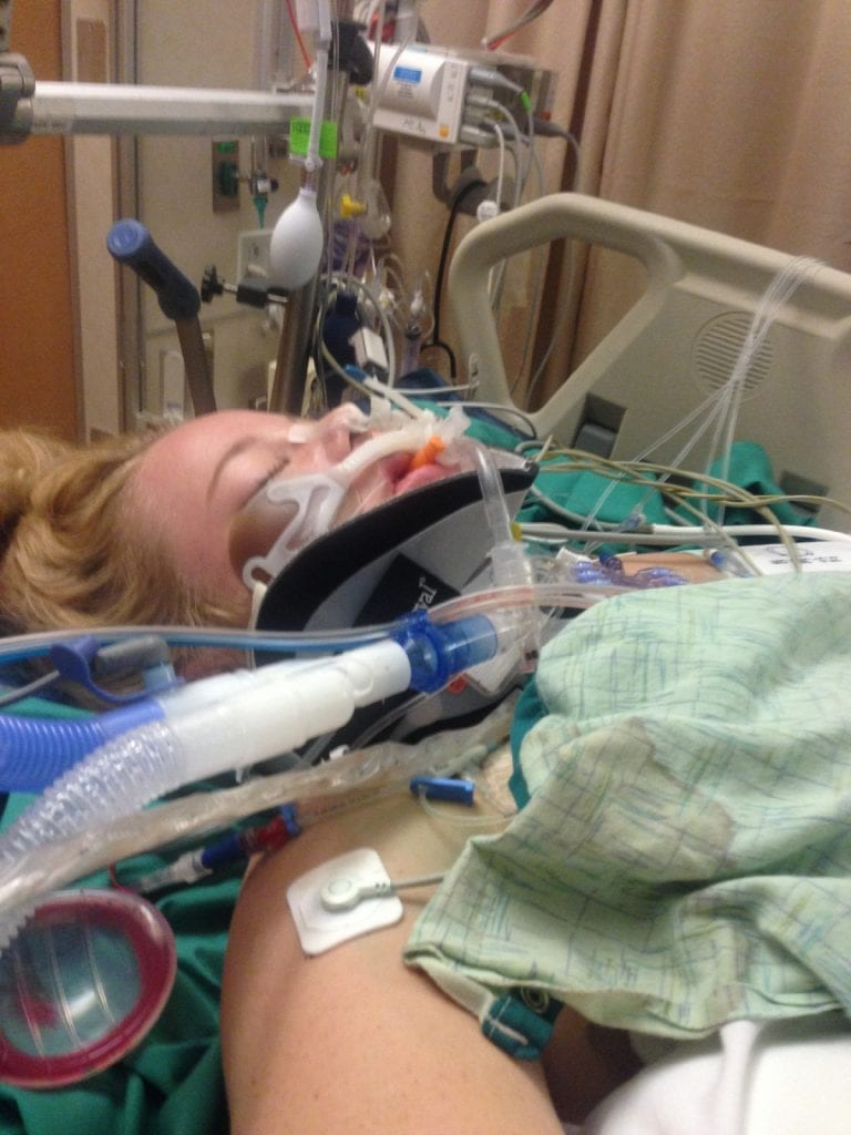 Devyn Brinkerhoff laying in her hospital bed. She was barely clinging to life at first after a bad accident.